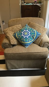 brown fabric sofa chair with blue and white floral pillow London, N6C 1L1