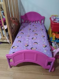 Pink and purple toddler bed with mattress included