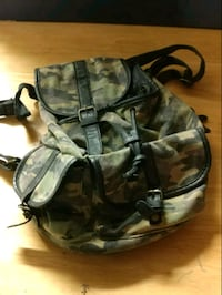 black and gray camouflage backpack 1963 km