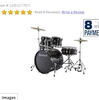 black acoustic drum set with text overlay