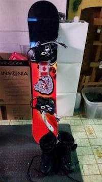 red and black snowboard with black bindings and pair of black leather snowboard boots
