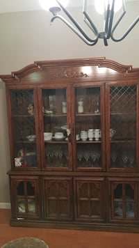Brown wooden framed glass display cabinet Vacaville
