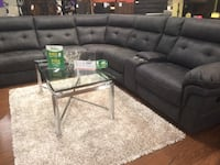Black leather sectional sofa with ottoman 1195 mi