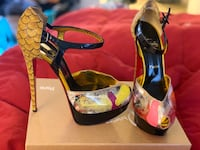 pair of black-and-yellow platform stilettos