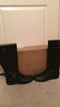 pair of black Born leather round-toe knee-high boots with brown box
