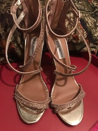 Pair of gold colored open toe ankle strap heels Alamo, 78516