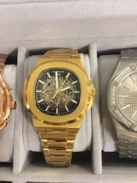 round gold-colored chronograph watch with link bracelet Richmond Hill, L4E 4Z6