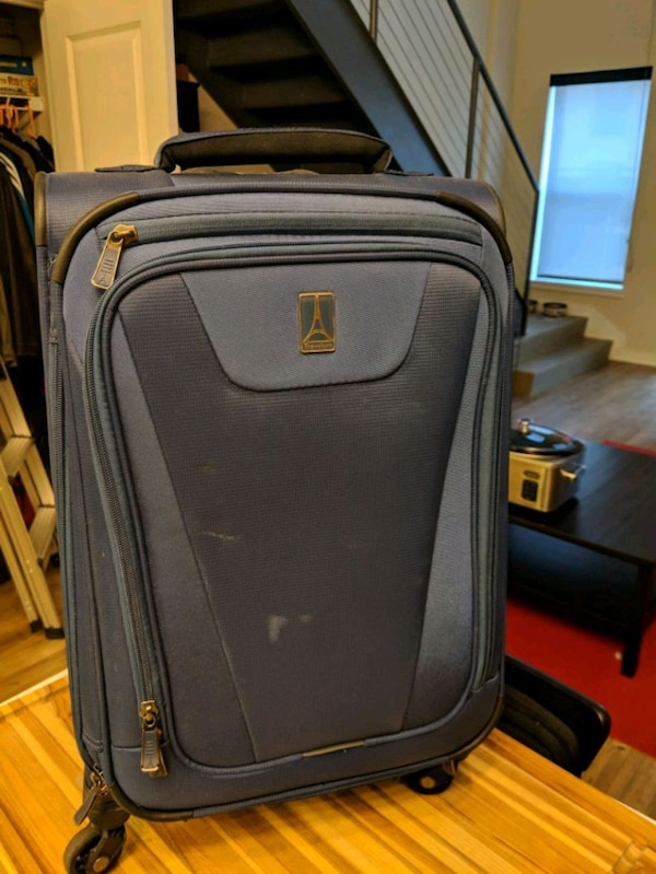 "Travelpro 21"" spinner suitcase"