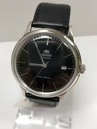 round silver-colored analog watch with black leather strap Longueuil, J4K 3T6