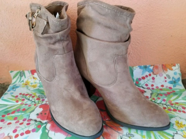 pair of gray suede boots 1