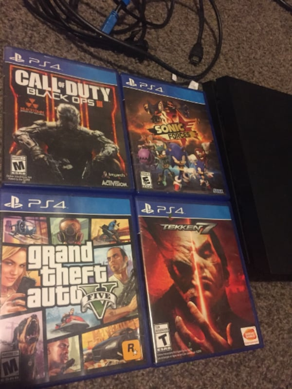 PS4 with all cords and 8 games but no controller  3aeb326a-6315-4063-9fb5-c556917299b6