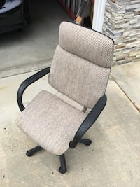 gray fabric padded rolling armchair