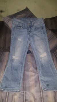 distressed blue-washed jeans