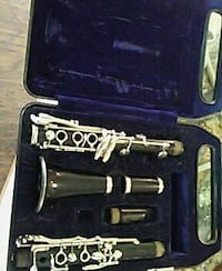 black and gray steel clarinet with blue case
