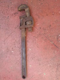 brown metal pipe wrench