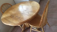 Oval brown wooden table with two chairs dining set