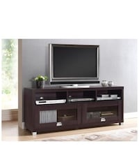 flat screen television with brown wooden TV stand Silver Spring, 20902