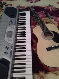 black and brown dreadnought acoustic guitar and silver Casio electronic keyboard Hartford, 06114