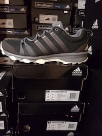 unpaired of gray and black Adidas low top sneaker with box