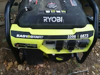 black and yellow Ryobi portable generator 50 km