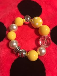 Yellow and clear beaded elastic bracelet