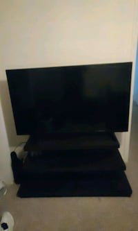 55 inch tv and wood stand New Smyrna Beach, 32168