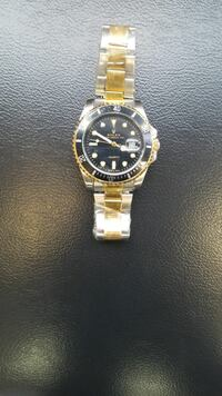 round black analog watch with gold link bracelet Guelph, N1E 0B3