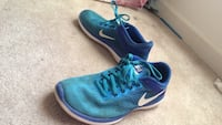 Pair of blue nike running shoes size 6 Gainesville, 20155