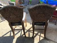 Two pub height heavy chairs