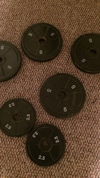 six metal dumbbell plate
