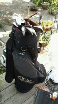2 golf bags.new nike shoe.big bucket full of balls Mason