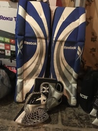 white and blue golie pads and glove Regina