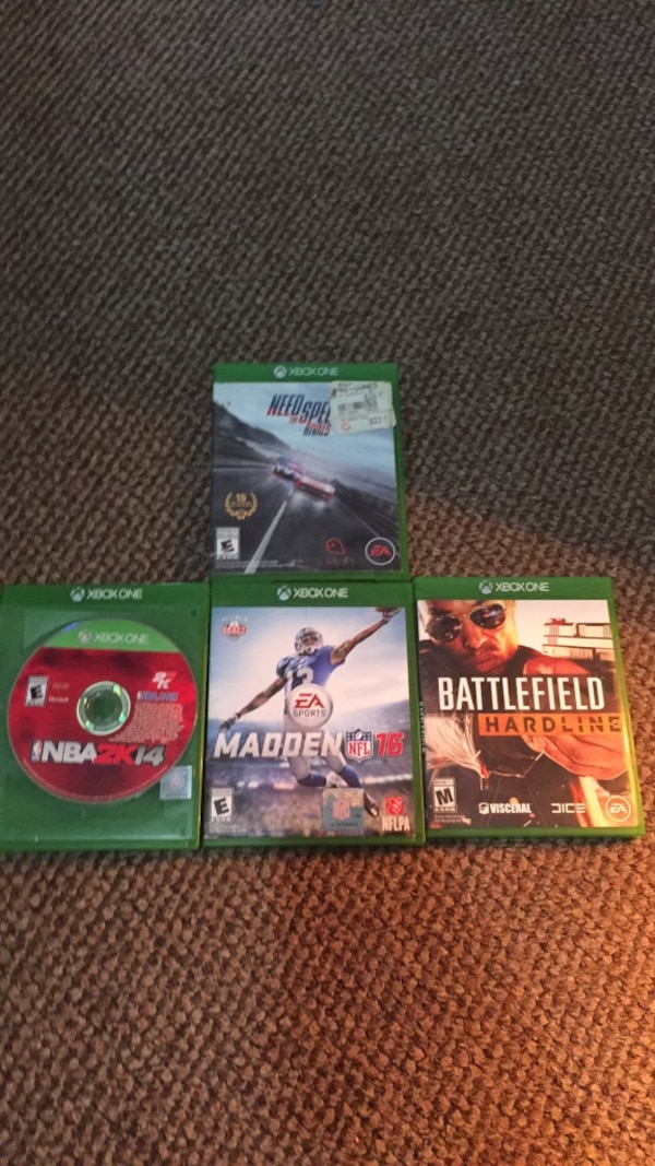 four Xbox One game cases cff5bf50-ad1c-4878-8941-a975b887f6c3