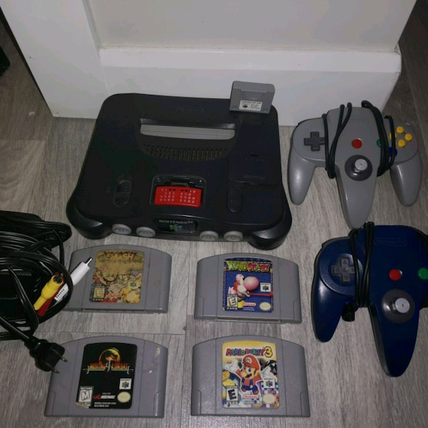 Nintendo 64 with expansion pak and 2 controllers