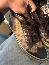 pair of black-and-brown Coach sneakers Southfield, 48075