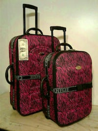 two black-and-pink luggage bags Pico Rivera