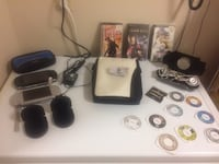 Two PSP's. One Grey the other Black with a lot of extras. Read info. Mississauga, L5L 5S1