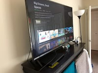 black flat screen TV with black wooden TV stand Hyattsville, 20785