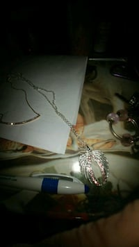 Pink and white stones necklace it's an angel wing for cancer beautiful