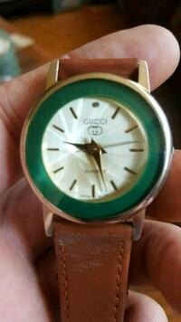 round green analog watch with brown leather strap Brampton, L6W 3G1