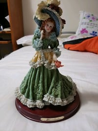 green ceramic figurine