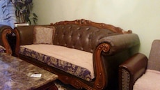 brown wooden framed couch