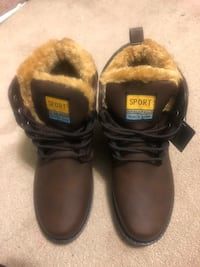 Pair of black leather work boots lined great for winter
