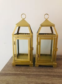 Two gold lanterns for wedding decorations