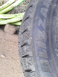 New Blizzak on RIm.  Tire size is in photos. Call JJ my number is next to my name Anchorage