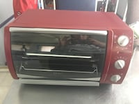red and stainless steel Oster toaster oven