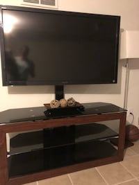 flat screen TV and black wooden TV stand Falls Church, 22046
