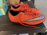 Pair of red and-black nike cleats size 3Y Brick, 08724