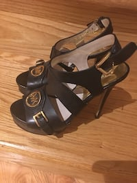 pair of black leather open-toe ankle strap heels Laval, H7X 3K6
