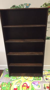 Solid chocolate coloured wood bookcase. Newmarket, L3X 2J4